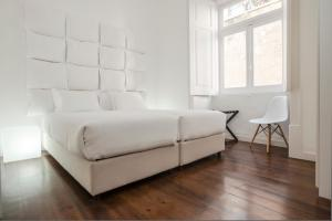 A bed or beds in a room at Se Vintage Apartment