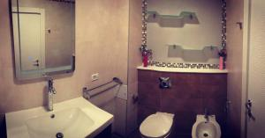 A bathroom at Glam Residence
