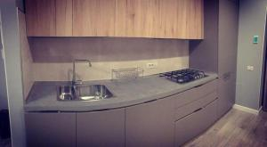 A kitchen or kitchenette at Glam Residence