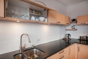 A kitchen or kitchenette at Planet Apartments