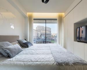 Un ou plusieurs lits dans un hébergement de l'établissement Mavi at Colosseum