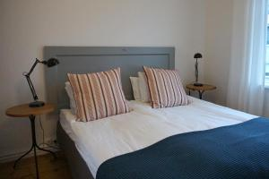 A bed or beds in a room at Nest Apartments