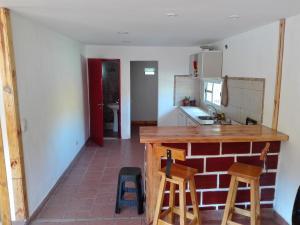 Una cocina o kitchenette en Casa de Vacaciones