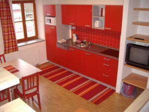 Kuchyň nebo kuchyňský kout v ubytování Apartmány Nové Hutě