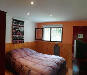 Una cama o camas en una habitación de Casa de Vacaciones