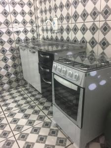 A kitchen or kitchenette at Apartamento próximo ao Centro Político e Shopping