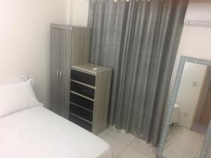 A bed or beds in a room at Apartamento próximo ao Centro Político e Shopping