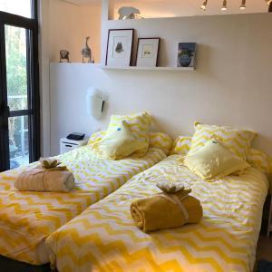 Een bed of bedden in een kamer bij Linden-Jachthoorn