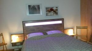 Ein Bett oder Betten in einem Zimmer der Unterkunft Ferienwohnung Jugl