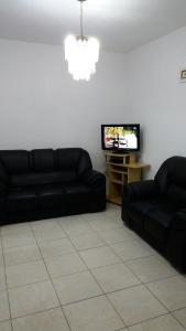 Zona de estar de Casa Cachoeira/Canasvieiras