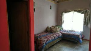Una cama o camas en una habitación de Al Sur 3