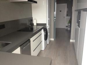 Una cocina o zona de cocina en Apartamento Sardinero Feygon