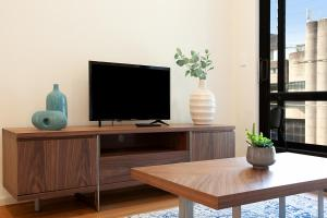 A television and/or entertainment center at CROWS NEST 5 - Hosted by: L'Abode Accommodation