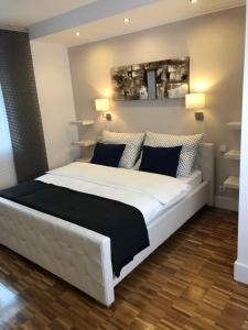 Ein Bett oder Betten in einem Zimmer der Unterkunft Apartment Ariana
