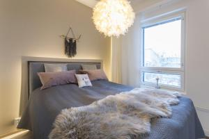 A bed or beds in a room at Tuomas´ luxurious suites, Ahola
