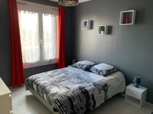 Un ou plusieurs lits dans un hébergement de l'établissement Appartement Le Grand Parc