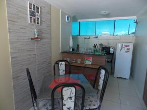 A kitchen or kitchenette at Flat Maragogi