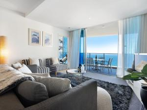 A seating area at 2 Bedroom Ocean View 27 Floors above H-Residences