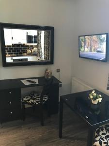 A television and/or entertainment center at So Sienna Apartments