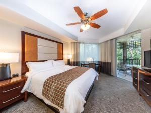 A bed or beds in a room at Marriott's Imperial Palms Villas