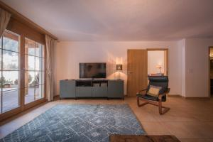 A television and/or entertainment center at Apartment Luterbach