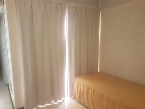 Una cama o camas en una habitación de Apart Hotel Express