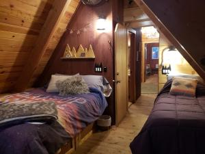 A bed or beds in a room at My Tahoe Ski Cabin