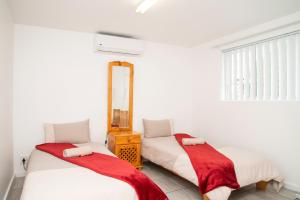 A bed or beds in a room at Anchorest Accommodation