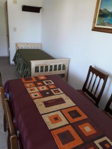 Una cama o camas en una habitación de Departamento Avda. Belgrano Sur 367