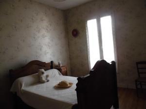 Un ou plusieurs lits dans un hébergement de l'établissement Gite lieu dit Gautier