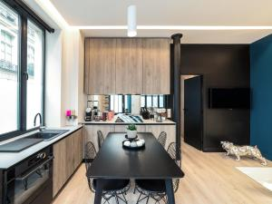 A kitchen or kitchenette at Exclusive Loft in Le Marais