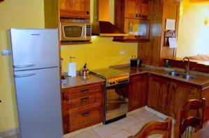 Una cocina o kitchenette en Posadas Aurelio