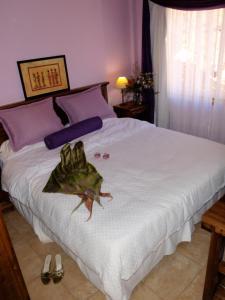 Una cama o camas en una habitación de Posadas Aurelio