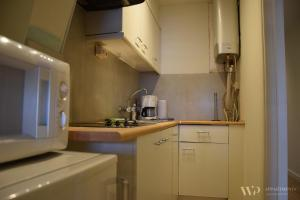 A kitchen or kitchenette at Appartement Lucia
