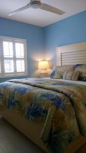A bed or beds in a room at Seven Mile Beach Oceanfront Luxury Villa