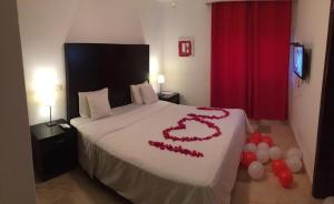 A bed or beds in a room at Karibo Punta Cana