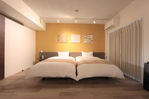 A bed or beds in a room at Riverside Arashiyama