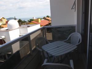 Un balcón o terraza de Residencial espelho das águas