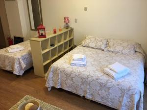Una cama o camas en una habitación de Habitar en Patagonia