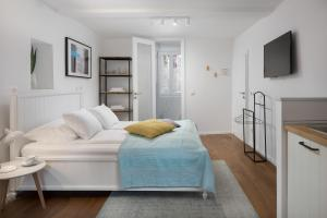 A bed or beds in a room at Irundo Rovinj - Old Town Apartments