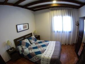 Cama o camas de una habitación en Apartamento los arcos