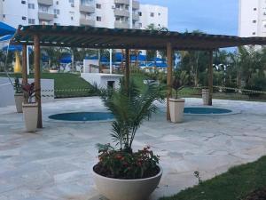 The swimming pool at or near Apartamento Suíte em Caldas Novas