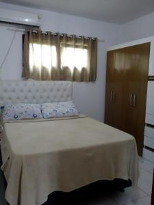 Cama o camas de una habitación en Casa com churrasqueira
