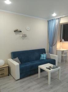 Гостиная зона в Apartment on Bratyev Tkachevykh 9