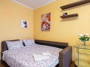 Un ou plusieurs lits dans un hébergement de l'établissement StigRealty Novocheremushkinskaia 21K1