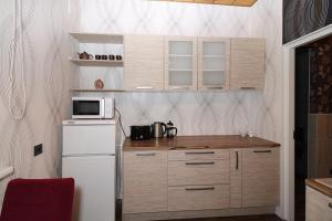 Majoituspaikan City Center EVM Bee Apartment keittiö tai keittotila