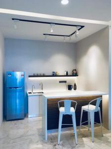 A kitchen or kitchenette at ⭐️YoYo Arte S @ USM,Bayan Lepas, Penang ⭐️
