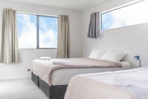 Uma cama ou camas num quarto em Brand New 5BR Villa near ShoppingMall