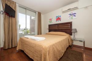 Cama o camas de una habitación en Bellavista Dardignac