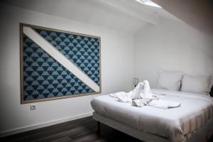 Un ou plusieurs lits dans un hébergement de l'établissement CMG-Parc des expositions-206